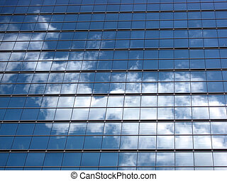 Glass wall with the reflection of sky
