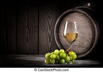 Glass white wine and bunch grapes