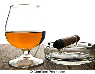 glass with a cigar