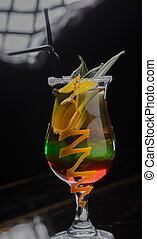 Glass with a cocktail on a glass table