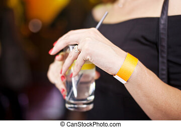 Glass with a drink in the hands of women