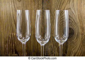 glass with champagne on a wooden background