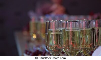 Glass with champagne or white sparkling wine at the party