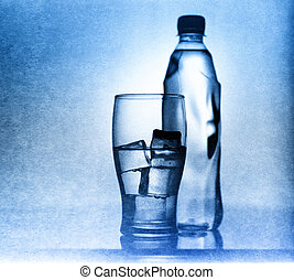 Glass with clear water, ice and bottle. Shot on 30 years old b/w film and Shneider Xenar 165mm lens.