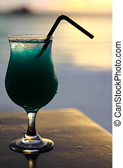 coctail - Glass with coctail on the beach during the sunset