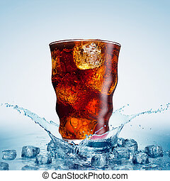 glass with cola and ice  in water splash
