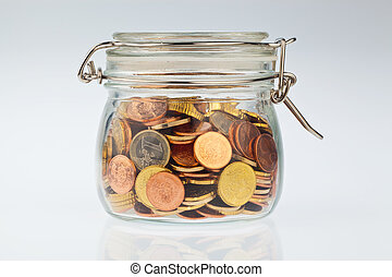 Glass with Euro coins - A jar of coins of the European...