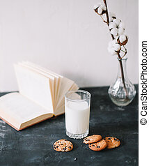 Glass with fresh milk and chocolate chips cookies. Oatmeal cookies and glass of milk for breakfast. Healthy good morning