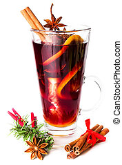 Glass with Hot red mulled wine with spices for winter and Christmas. Orange slice, anise and cinnamon sticks isolated on white background, closeup.