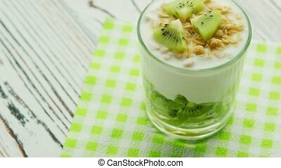 Glass with kiwi and yogurt - From above shot of glass filled...