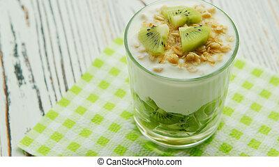 Glass with kiwi and yogurt