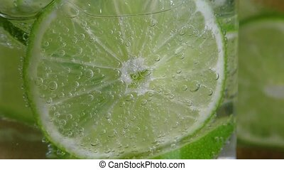 Glass with lime and sparkling water