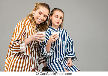 Positive young ladies spending time together and drinking ...