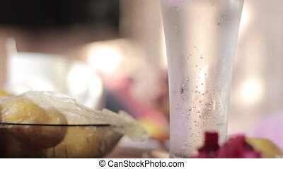 glass with mineral water on a table, rural breakfast from...