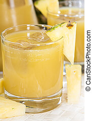 Glass with Pineapple Juice and Ice Cubes