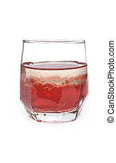 glass with red liquid and bubbles of oil on a white background