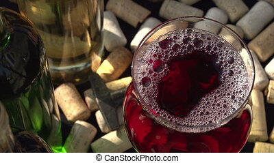 Glass with Red Wine on the Move