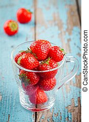 glass with ripe organic strawberries