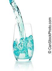 Glass with splashing blue drink