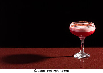 glass with the red cocktail