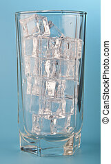 glass with water and ice on a blue background