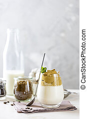 Glass with water drops of iced frothy drink Dalgona Coffee, ...