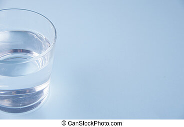 Glass with water on a blue background