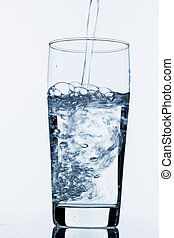 glass with water - water is poured into a glass, symbolic...