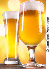 Glasse of beer with gold background