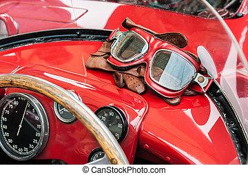 Glasses and gloves inside a vintage red car