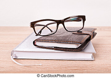 Glasses and notebooks