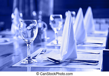 Glasses and plates on table in restaurant