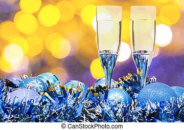 glasses, blue Xmass balls on blurry background 1