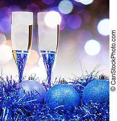glasses, blue Xmass balls on blurry background 11