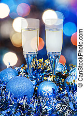 glasses, blue Xmass balls on blurry background 7