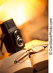 Glasses, book and film camera