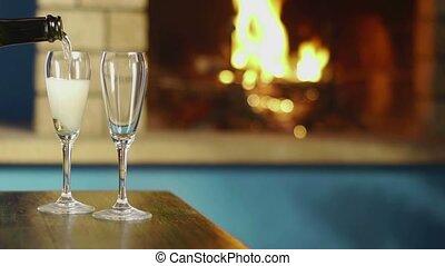 Glasses, bottle of champagne, fire