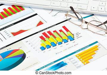 glasses, business papers with charts - glasses, business ...