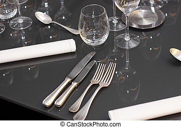glasses, cutlery on the table a great restaurant