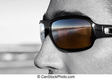 Glasses - Dark glasses reflect the beach,selectively...
