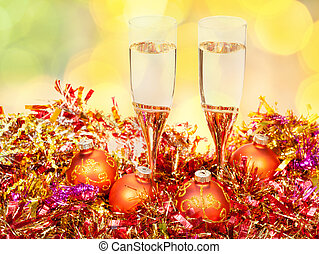 glasses, gold Xmass balls on blurry background 3