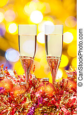 glasses, gold Xmass balls on blurry background 6