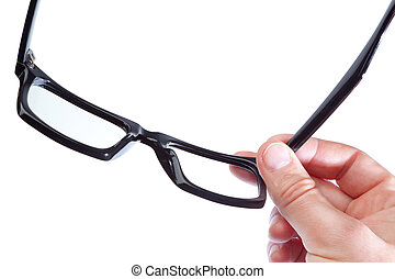 Glasses in the hand of a man on a white background. Close-up.