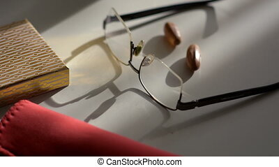 Glasses lie on a light table and the motion of shadow -...