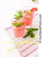 Glasses of a fresh pink lemonade.