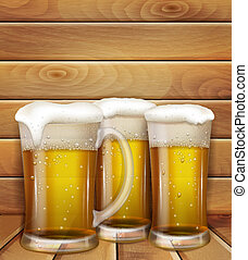 glasses of beer and a wooden background