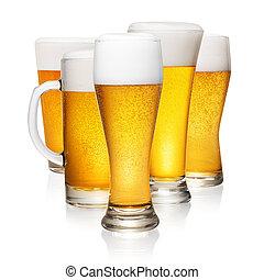 Glasses of beer on white