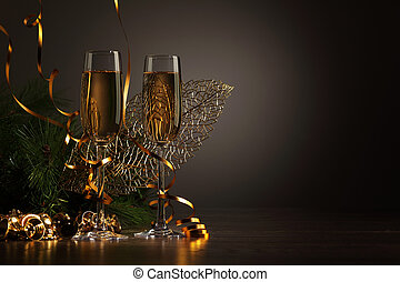 Glasses of champagne at new year party - Two champagne...