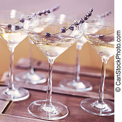 Glasses of champagne decorated with lavender on blurred...