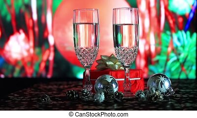 Glasses of champagne on background